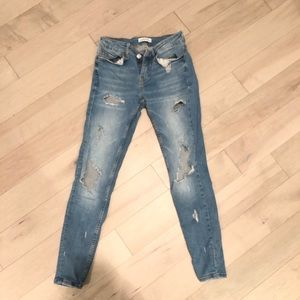 Ripped blue jeans from Zara